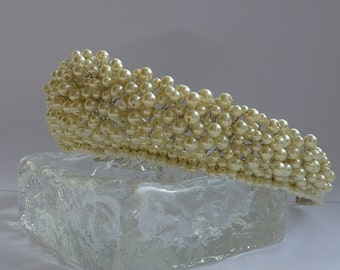 Tiara: Hollywood glamour with this traditional tiara filled with hundreds of ivory glass pearls