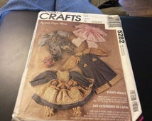 Vintage McCalls craft pattern cloths pattern for bunny wraps differnt doll outfits
