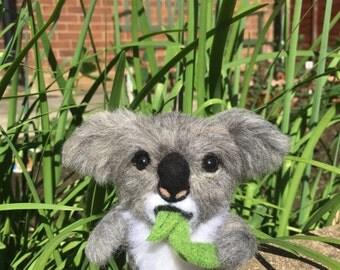 Needle wool felt of a Koala on a walking device