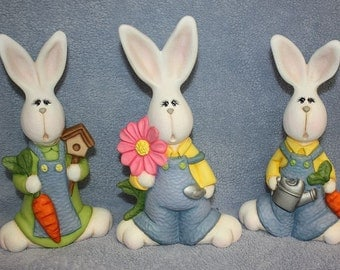 Adorable ceramic Bunny Set one Rabbit with a flower one with a pail and one with a bird house