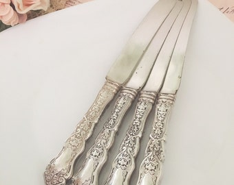 vintage  silver plate butter knife, butter knives , cheese spreaders   (4 pieces)