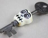 Bullseye skull on skeleton key (Item 160119)