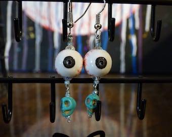 Blue skull eyeball earrings