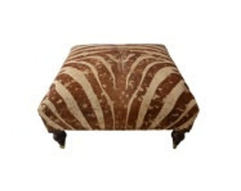 Bench/Ottoman upholstered with gorgeous zebra hide with gold accent