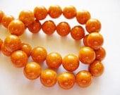 Fossil Beads Orange Round 10mm