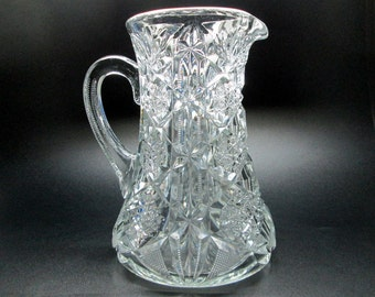 Pressed glass water pitcher , looks a bit similar to Mckee Martec , looks like cut glass blown pontil