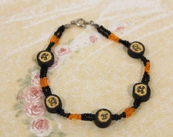 Orange and Black With Sun / Face Beads Fashion Bracelet