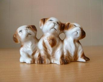 Three ceramic puppies