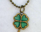 Lucky Charm Antique bronze Emerald green Shamrock four leaf clover Green resin pendant necklace Luck of the Irish St. Patrick's Day