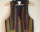 Sleeveless striped vest size medium