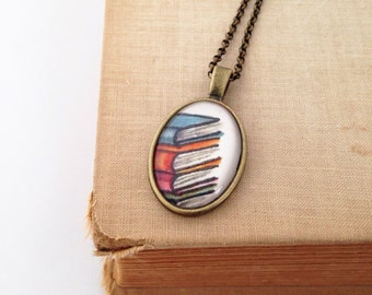 Read.  Stack of Books Drawing.  Brass Necklace.