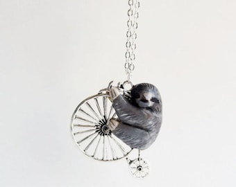 Sloth on the bicycle , Clay Pendant, Sloth necklace / MADE TO ORDER