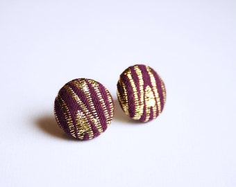 Fabric covered button earrings in purple and gold, stripy, stripey