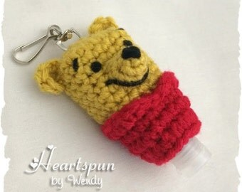 Winnie the Pooh inspired Hand Sanitizer Holder with clip to attach to a key chain or bag.  Hand crocheted, fits 1 oz hand sanitizer bottles