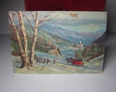 1950's-60's mid century christmas card outdoor scnen people in horse drawn sled in the country, house, church, mountains, glitter accents