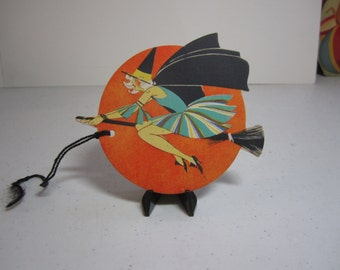 Gorgeous unused art deco 1920's Buzza die cut gold gilded halloween bridge tally flapper witch riding on her broomstick past a full moon