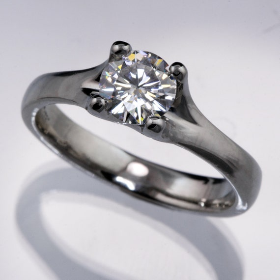 Forever Brilliant Moissanite Classic Solitaire Sculpted 4 Prong Alternative Engagement Ring in Palladium, White Gold, Rose Gold, Yellow Gold