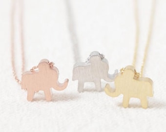 ELEPHANT necklace << gold luck charm << because you can't wear a real elephant