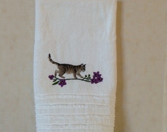 Frisky Calico Cat in Flower Border machine embroidery on white ruffled hand towel