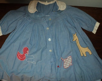 Vintage Girl's Smocked Blue Cotton Dress, Size Five (5) with the Cinderella Label with 2 animal and Toy appliqué  in Vintage Condition