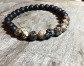 Mens black oxidized skull turritella shell fossil  beads and matte onyx beaded bracelet