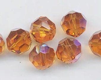 24 Swarovski sparkliing crystals - art 5000 - 6 mm - topaz AB