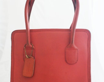 Coach- Coral Pink Leather Small Dinkey Lunch Tote with brass feet