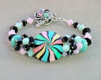 Pink. aqua, mint green and black striped swarovski crystal cluster bracelet, polymer focal beaded cuff bracelet,  jade green black stripes