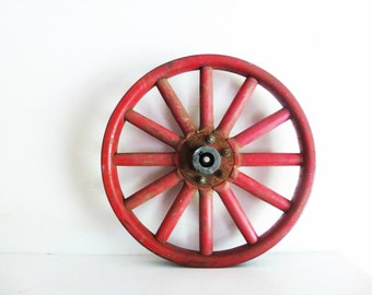 Red Metal Wheel With 12 Wooden Spokes,