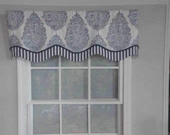 Medallion layered shaped window valance with trim