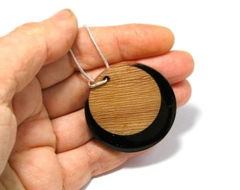 Resin and wood necklace. Modern jewelry. Pop. Contemporary jewelry. Wood jewelry. Black, Round circle dot