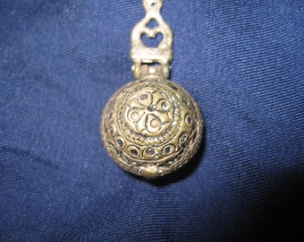 old medallion-amulet metal patina height 4 cm