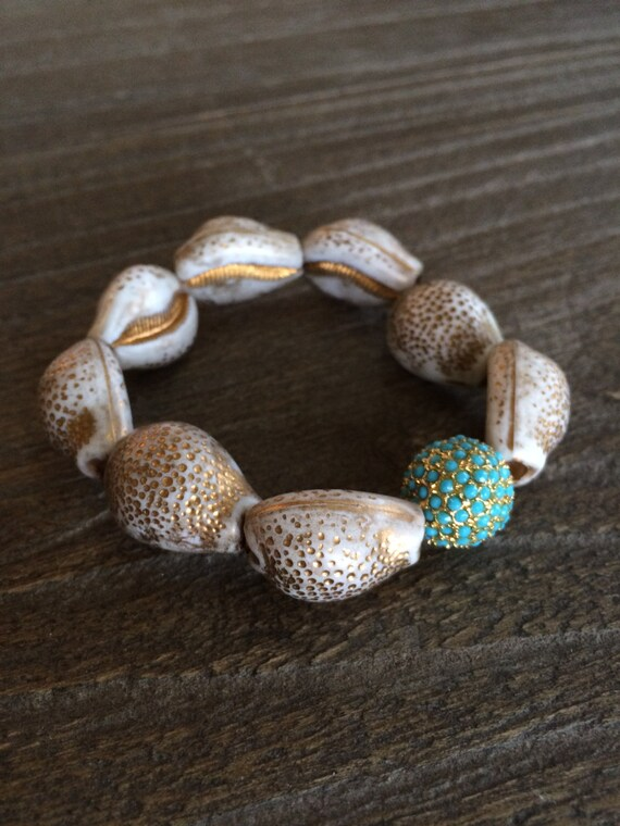 Turks and Caicos bracelet - Modern, elegant & preppy.  Vintage resin shell beads grounded with a turquoise, gold plated crystal pave bead
