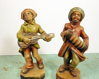 Pair of Chalkware Musicians Accordian Player and Guitarist Figurines