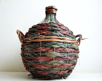 Vintage Small DEMI JOHN, Dame Jeanne, Dark Green Glass Bottle in Wicker Basket, Contains about 5 liter.