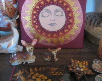 Hand painted Sun face art canvas panel.