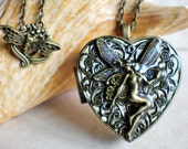 Fairy music box locket,  heart shaped locket with music box inside, in bronze with fairy and bronze filigree.