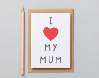 Happy Mothers Day Card. Fun paper cut lettering with a bright heart.