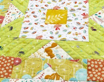 Lap quilt with cute animal print. A small quitl for kids. Cute quilt throw.