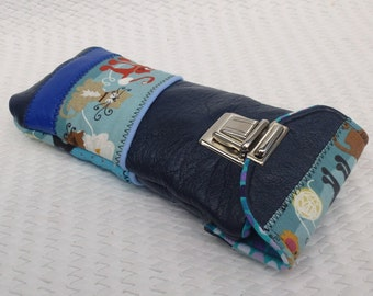 bezel case closed satchel in blue leather and fabric cats