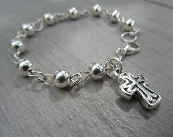 Sterling silver rosary bracelet. 10 bead rosary with puff cross