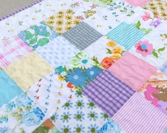 Patchwork baby quilt made from vintage sheets and scraps