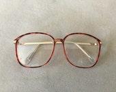 Revlon nerdy peach leopard pattern eyeglasses frames readers +1.25 vintage 1980's 52-16-135