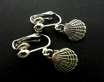 A pair of cute little tibetan silver seashell clam shell  dangly clip on earrings.