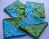 Folded fabric coasters, mug rugs, candle mats, home décor, bright coasters, little quilts, quilted coasters, coaster set