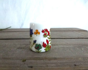 miniature candle holder with floral design