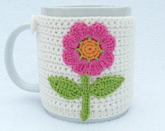 Cream crochet mug cozy with flower applique