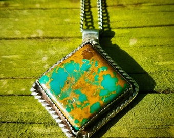 Turquoise & sterling silver pendant.