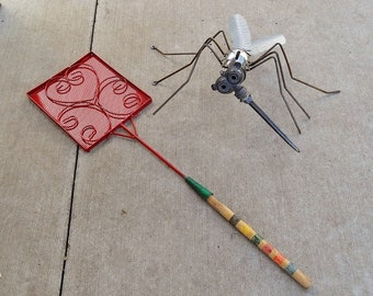 Skeeter and Her Nemesis ~ over-sized welded mosquito sculpture.