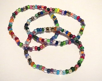 3 Multicolored stretch seed bead bracelets. Green, blue, orange, purple, yellow, pink, red beads. Customizable, perfect for kids or adults